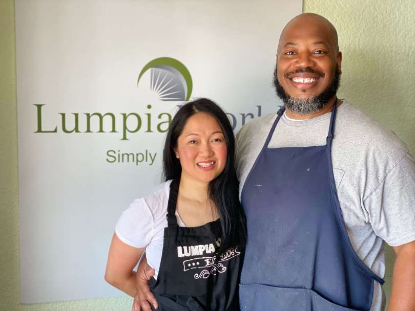 Eleanor (left) and Derrick Ellis (right), owners of Lumpia World, standing in their restaurant.