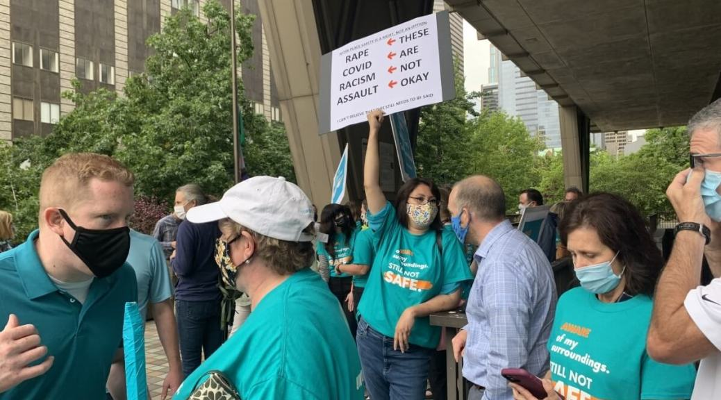 King County employees gather outside the courthouse downtown to protest for safer public spaces, Aug. 6, 2021. (Photo by Hannah Krieg)