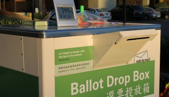 Photo of a King County ballot drop box with a countdown clock above it.