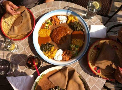 Plates of food from Meskel Ethiopian Restaurant enjoyed on the restaurant's patio. (Photo: Meskel Ethiopian)