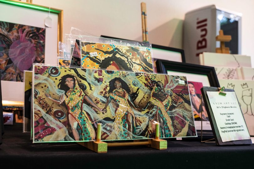 Photo depicting colorful artwork by Stephanie Morales set up for sale at The Liink Project
