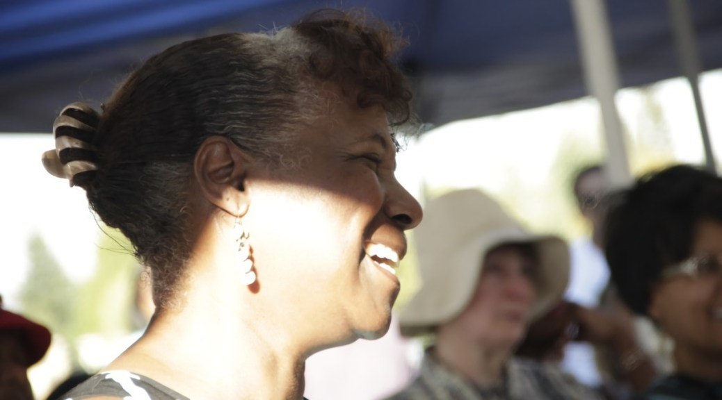 Photo depicting a close-up of Cynthia A. Green smiling and laughing.