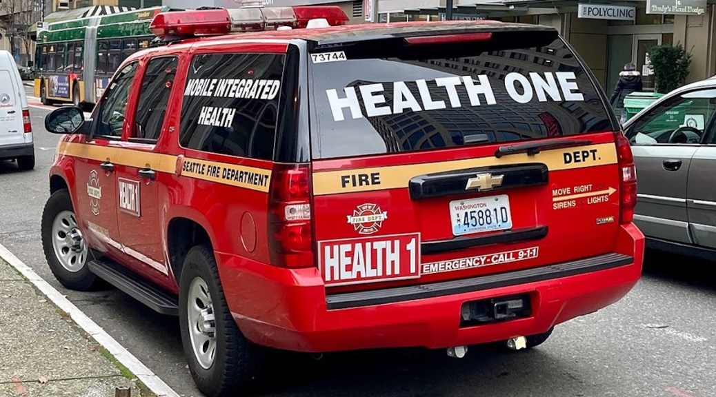 """Red and gold """"Health One"""" SUV from Seattle Fire Dept."""