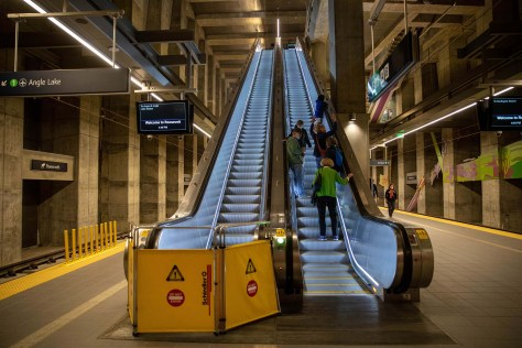 Photo depicting the interior of the Roosevelt light rail station escalators going up from the platform.
