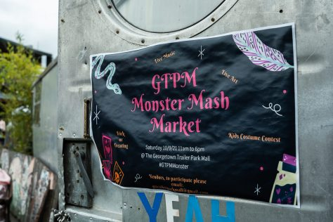 """Photo depicting a black banner with hot-pink text that reads, """"GTPM Monster Mash Market."""""""