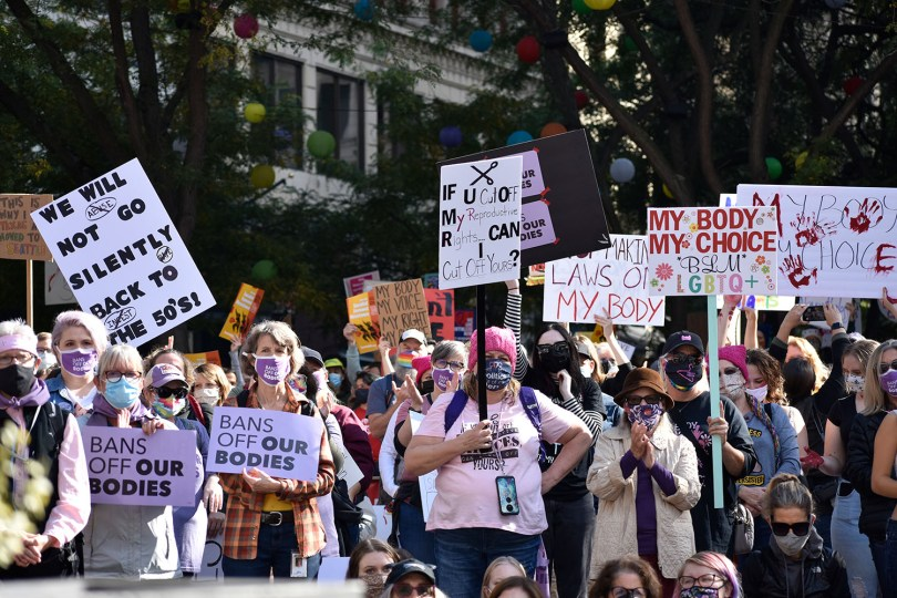 Photo depicting a group of protestors carrying protest signs at the Rally for Reproductive Justice in Seattle