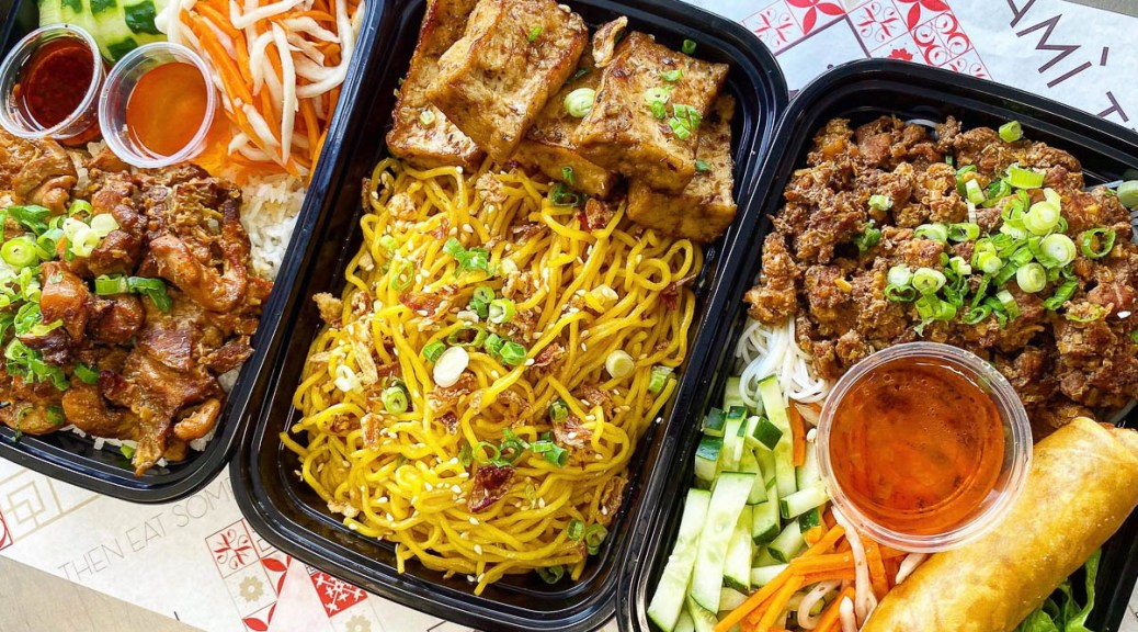 Photo depicting three packaged takeout meals containing Vietnamese food from Mami Tran.