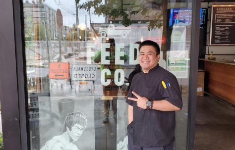 Chef Francis Fernandez stands in front of Feed Co. Burgers in the Central District. (Photo: Feed Co. Burgers)