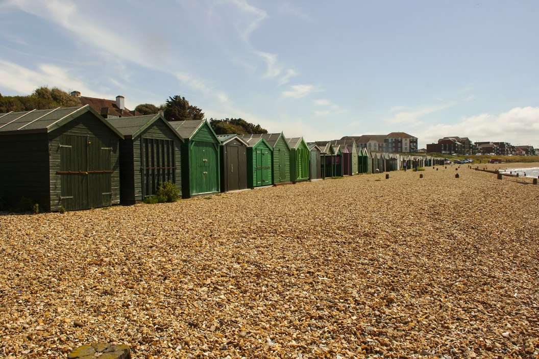 Traditional English family Beach Huts at the pebble beach at Titchfield in Hampshire in the South of England