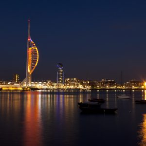 Watefront of Portsmouth, England, with Spinnaker Tower and docklands at night