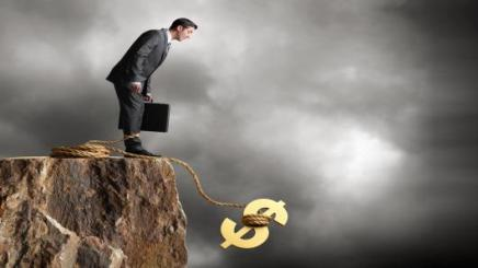 100296661-fiscal-cliff-taking-businessman-down2-gettyp-530x298