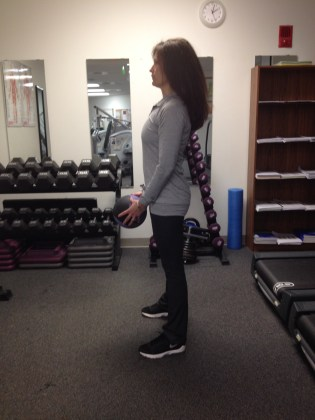 Medicine Ball Squat and Arm Curl Start Position First Commercial Break