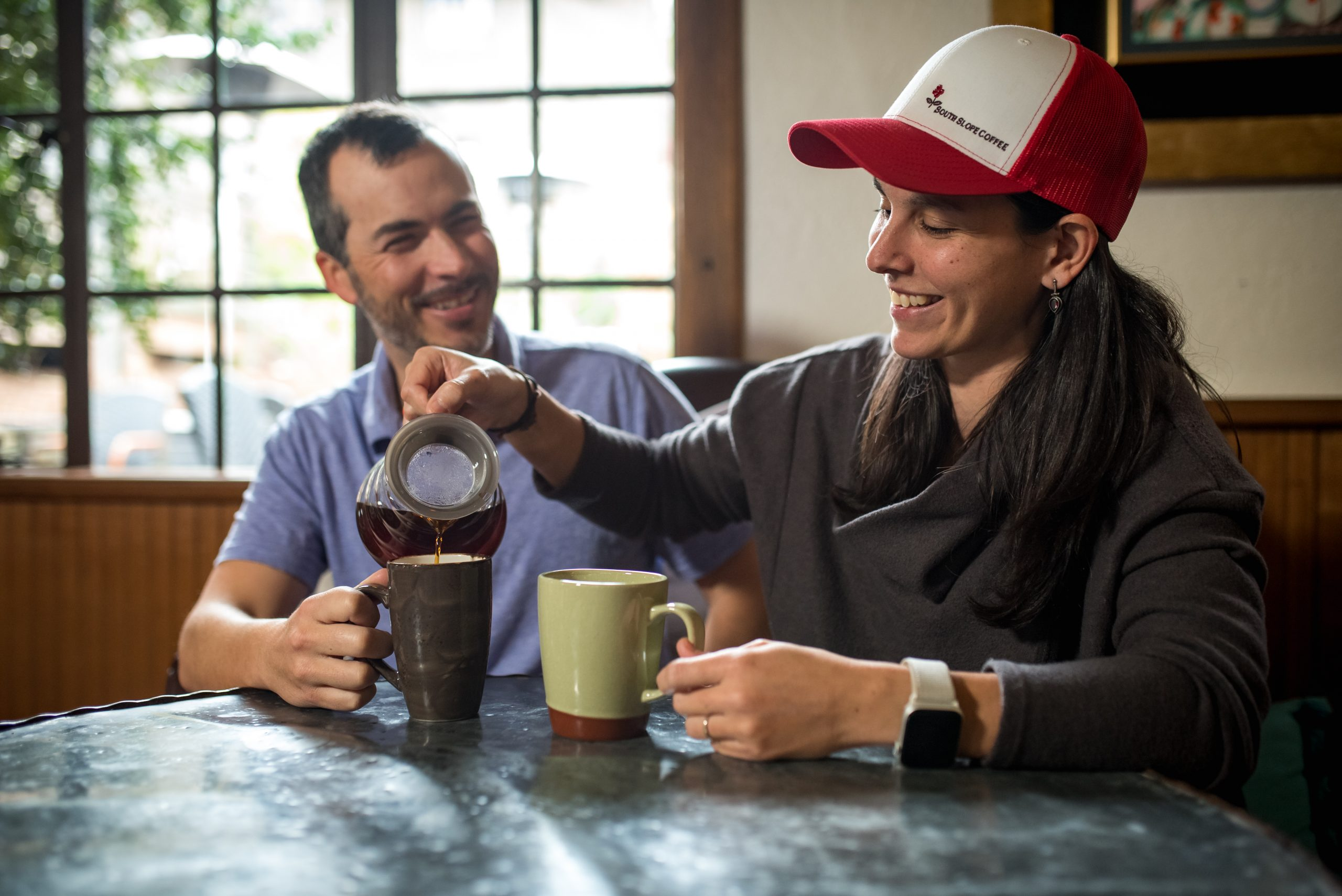 Luis And Cristina From South Slope Coffee Drinking Coffee Together