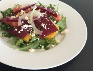 Cafe Thyme roasted beet arugula salad with citrus dressing and feta