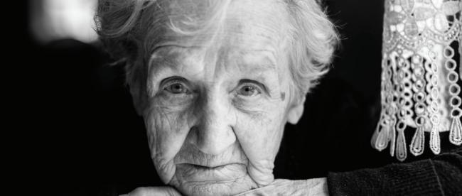 senior woman staring a camera: b/w photo