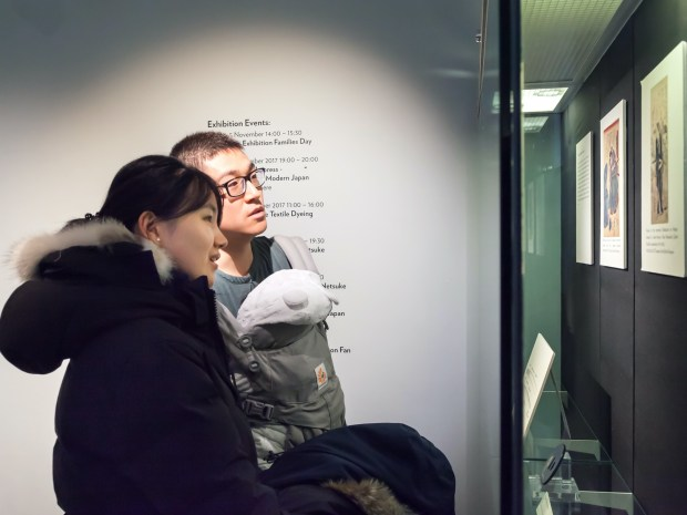 Couple looking at exhibit