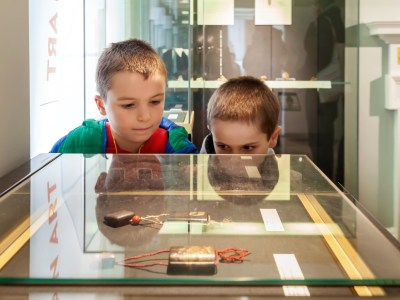 Two children looking into glass case