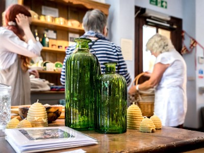 Glass bottles with two women behind