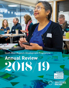 Annual Review Front Cover - A training delegate smiles as she learns about animation