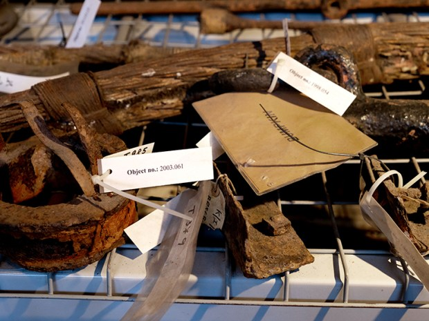 A museum display of rusty objects