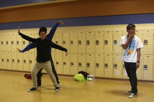 Joesph Salvador, sophomore, is choreographing a dance as he teaches sophomores Gary Cheng and Zack Wong dance moves. He is demonstrating proper head placement for that particular move.<br />Photo Credit: Raymond Tang