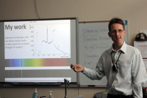 Physicist Ross Tucker presents his PowerPoint to the class about quantum mechanics.<br>Photo Credit: Bree Eure