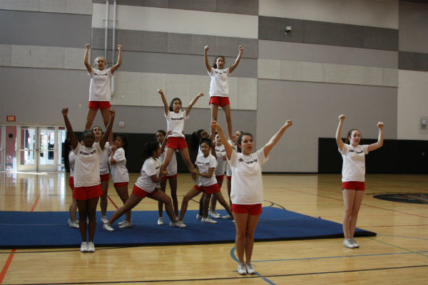 "The cheerleaders practice their dance routine for the halftime performance. They have spent countless hours after school perfecting the routine. ""I'm very excited about the bowl game, but also anxious. We've all worked very hard to put the routine together, so we can't wait to perform it,"" Junior Madison Chang said.  Photo Credit: Mika Pagado"