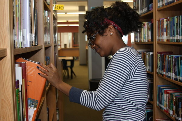 Mariamawait Moges browses through books in the library for research of the body.  Photo Credit: Michelle Manuel
