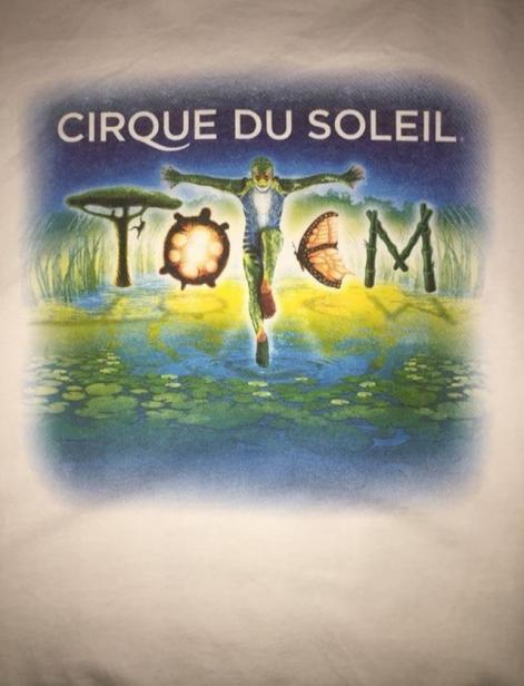 "Cirque Du Soleil merch shirt designed by Buiniakou. Buiniakou worked on this shirt with the help of other designers. ""For five years I have been designing posters and shirts,"" Buiniakou said. ""After two years, I will move to a new company for a full time contract."""