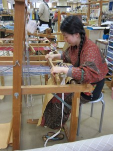 weaving Nishijin Textile Center as part of a demonstration.