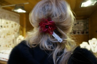 Linds models a handmade barrette at Vendor at Freyung, one of the best Vienna Christmas Markets.