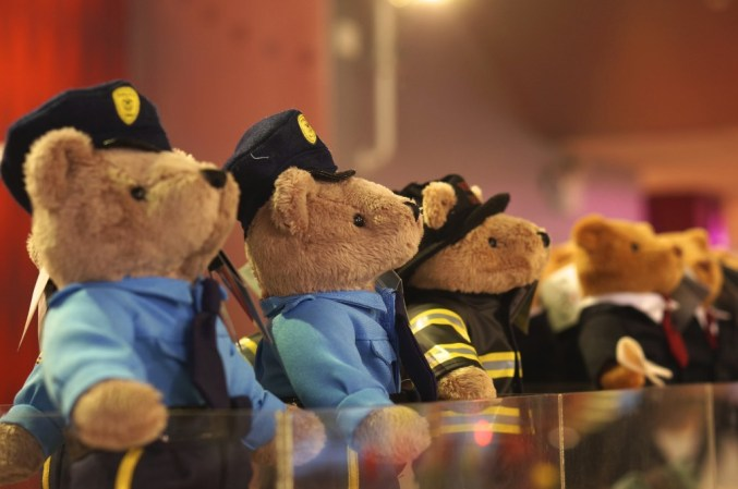 FAO Schwarz police and firemen bear stuffed animals.