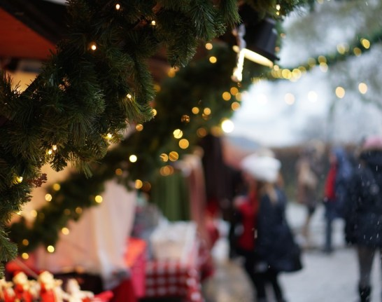 Boughs of garland and Christmas lights trimmed the stalls at Stockholm's Kungstradgården Christmas market
