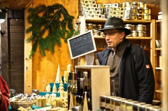 Vienna Austria Spittelberg Christmas Market vendor alpine hat stall beeswax candles
