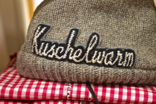 Not sure of the exact translation-- warm and cuddly? Nice and warm? But this hat is adorable.