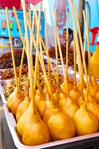 Chatuchak Market JJ Market Bangkok Vendor Street Food Sausage Wrapped Pastry Pong Neng