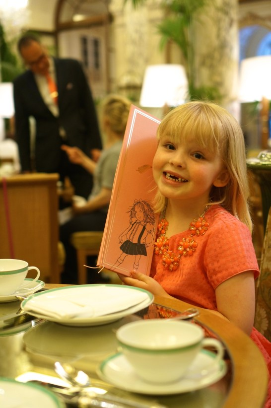 Avery poses with the Eloise menu.