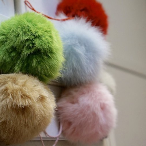 Fluffy pom poms to accessorize pretty much anything.