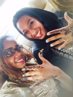 Weddings are a big deal in Sudan. One way that women (including guests) prepare for the event is by getting henna tattoos. In Sudan it is most common to see black henna instead of red. Pictured above is me with my cousins on the road to a wedding.