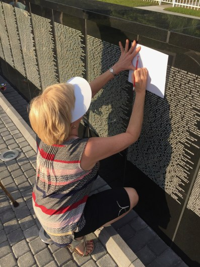 My sister, also a veteran, doing rubbings for Allen Masteller and John Cook, members of the 34th