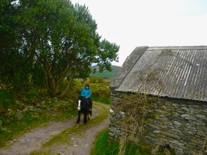 Souzz cruising past an old stone building