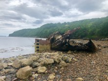 An old fishing vessel shipwrecked on the beach