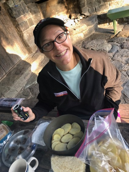 Souzz assembling the Potato Gratin Savoyard, a backcountry favorite of ours