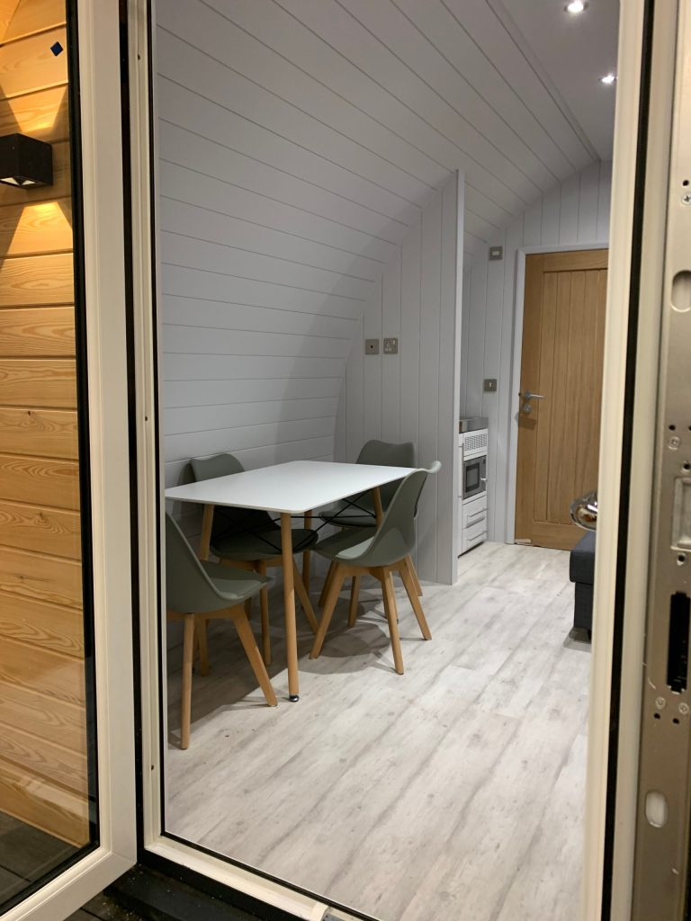 glamping pod interior shot of dining area with table and chairs