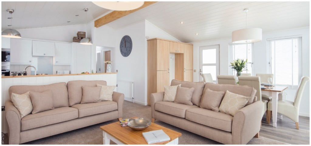 Resized - The summer haven holiday lodge - open plan kitchen, spacious living room & dining area with large windows and vaulted ceiling - interior photo