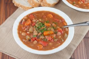 This Instant Pot 15 Bean Soup Recipe is a meatless one-pot dish that is made so much faster by cooking dried beans right in your Instant Pot with the soup. Perfect for a healthy weeknight dinner!