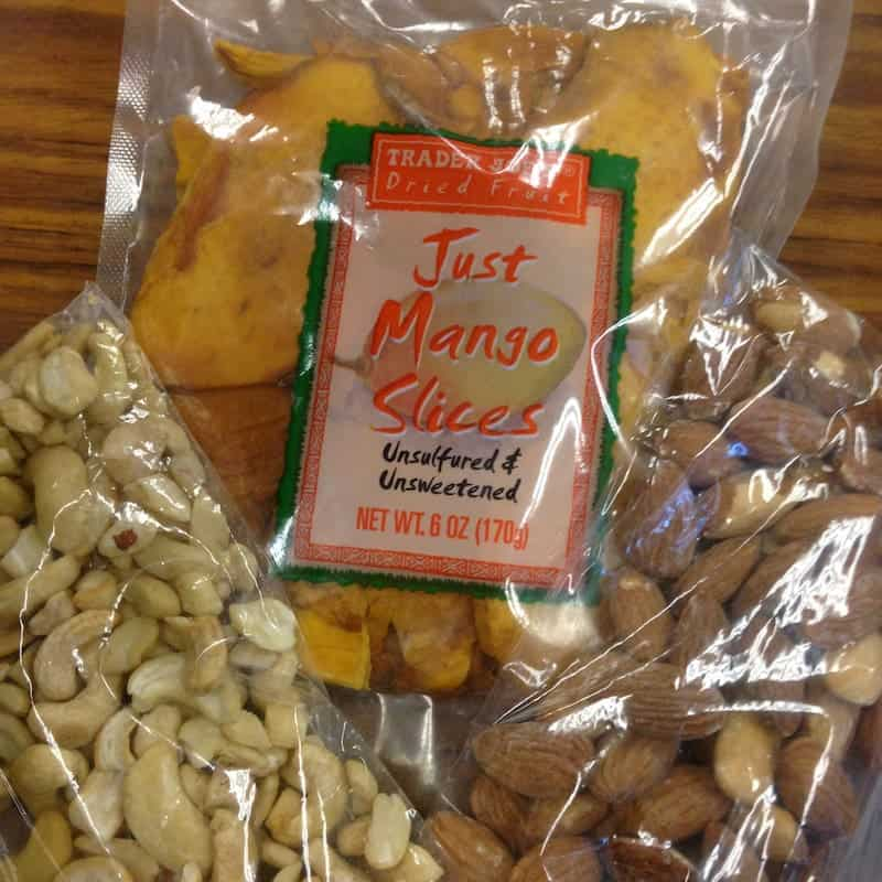 Bags of dried mango slices, cashews, and almonds