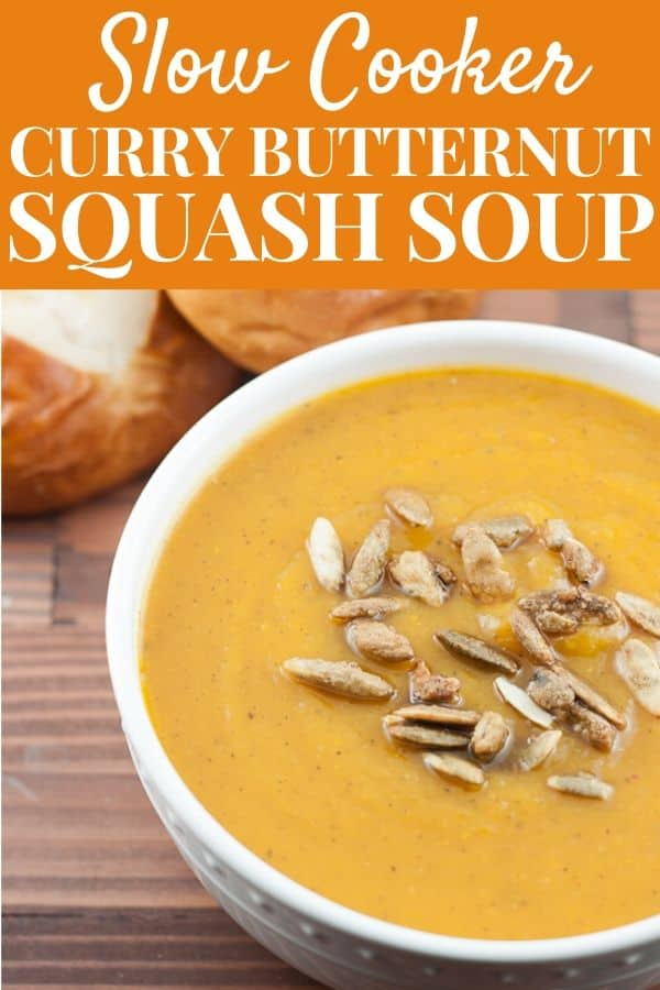 Bowl of slow cooker curry butternut squash soup topped with roasted pumpkin seeds