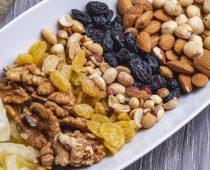 top view mix nuts walnuts raisins peanuts and almonds