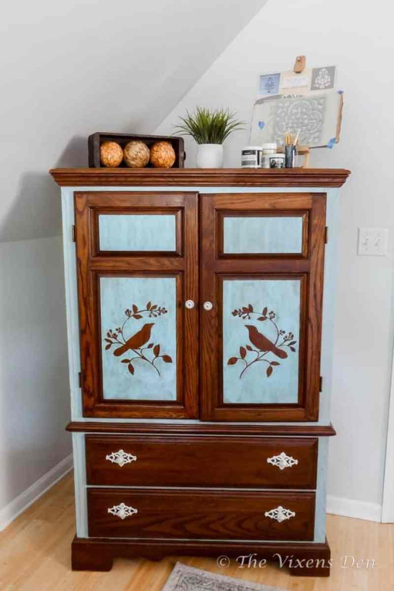 paint washed and stained armoire/craft cabinet with white hardware